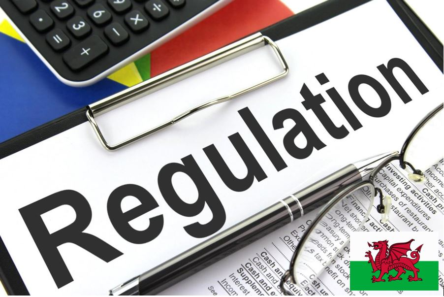 A picture of Regulation sign with Welsh Flag