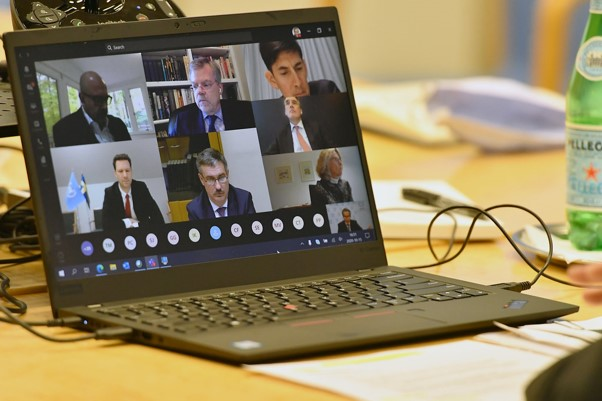 A picture of a laptop showing a video conference meeting